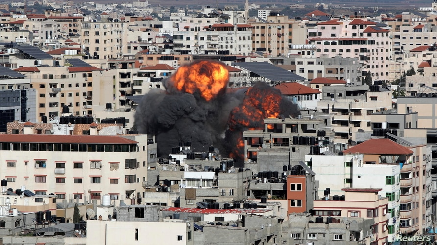 Smoke and flames rise during an Israeli air strike, amid a flare-up of Israeli-Palestinian violence, in Gaza City May 14, 2021…