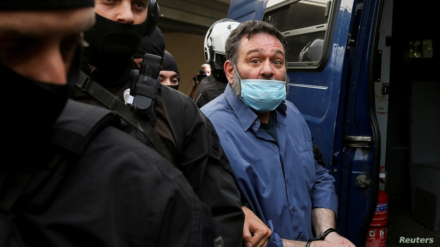 Greek Member of the European Parliament and former member of Golden Dawn Ioannis Lagos is escorted by anti-terrorism police…