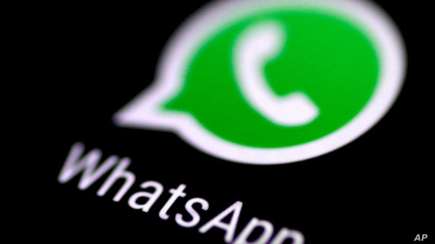 FILE - The WhatsApp messaging application is seen on a phone screen.