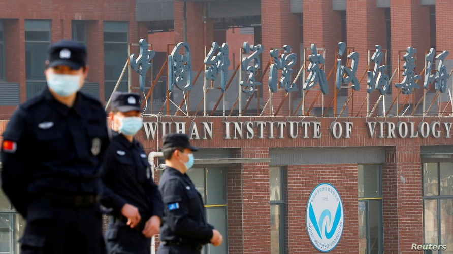 FILE PHOTO: FILE PHOTO: Security personnel keep watch outside the Wuhan Institute of Virology during the visit by the World…