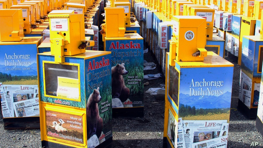 Hundreds of old newspaper sales boxes are shown Monday, Sept. 11, 2017, in a vacant lot near the former offices of the Alaska…