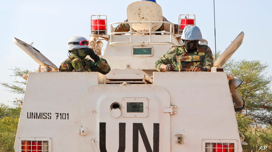 In this photo taken Friday, Dec. 7, 2018, UN peacekeepers in an armored personnel carrier lead a patrol from Bentiu towards the…