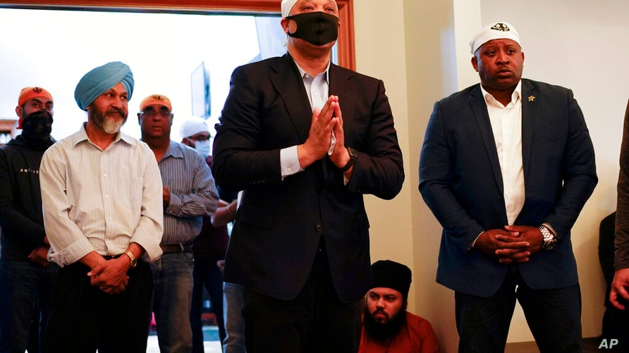 Rep. Andre Carson, D-Ind., speaks with members of the Sikh Coalition at the Sikh Satsang of Indianapolis in Indianapolis,…
