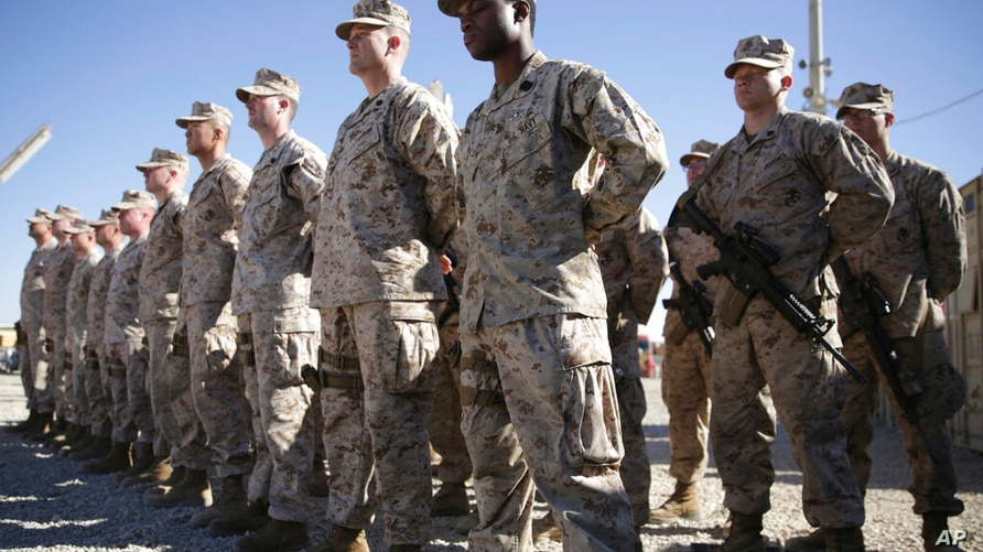 FILE - In this Jan. 15, 2018, file photo, U.S. Marines watch during the change of command ceremony at Task Force Southwest…