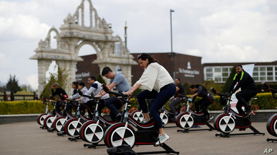 """People take part in """"Cycle to Save Lives"""" a 48 hour, non-stop static relay cycle challenge at the BAPS Shri Swaminarayan Mandir…"""