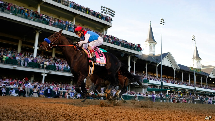 John Velazquez rides Medina Spirit across the finish line to win the 147th running of the Kentucky Derby at Churchill Downs,…