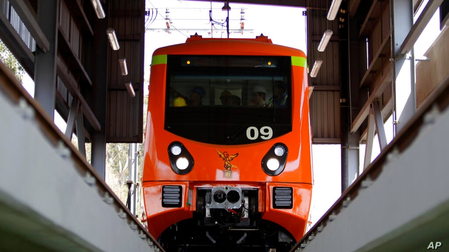 FILE - In this Jan. 20, 2012 file photo, engineers test one of the newly acquired Spanish built subway cars slated for the…