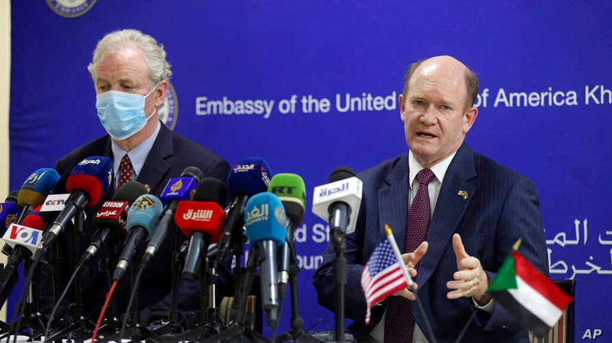 U.S. Senators Chris Coons, right, (D-Delaware) and Chris Van Hollenspeaks (D-Maryland) give a press conference at the Corinthia…