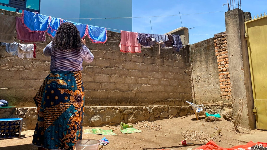 Reby hangs laundry outside her home in Beni, eastern Congo, on Saturday, May 1, 2021. In 2019, she met World Health…