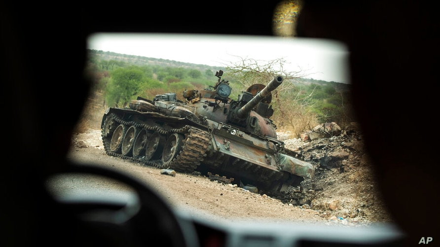 A destroyed tank is seen by the side of the road south of Humera, in an area of western Tigray annexed by the Amhara region…