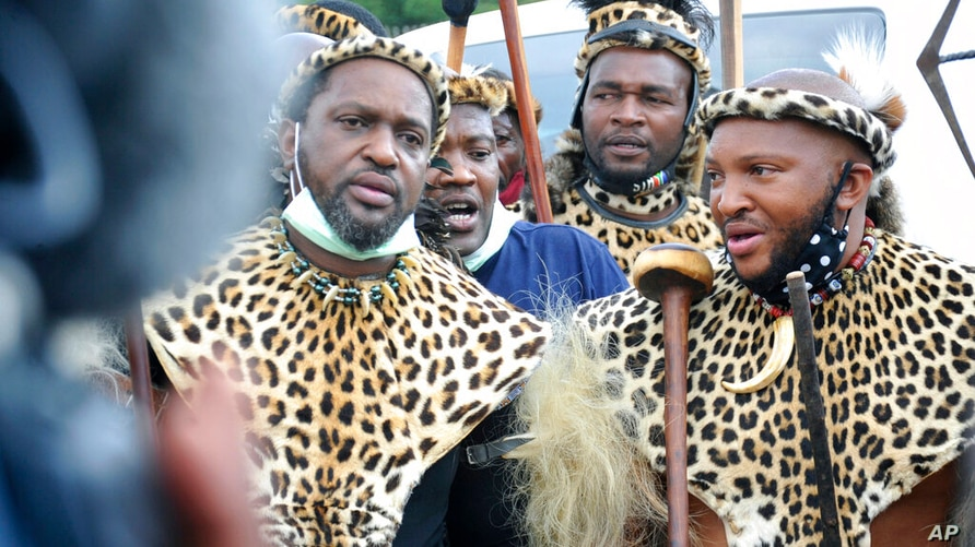 Prince Misuzulu Zulu, left, flanked by fellow warriors in traditional dress at the KwaKhangelamankengane Royal Palace, during a…