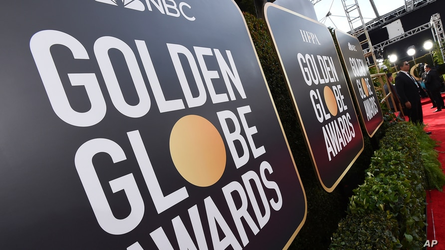 FILE - Signage promoting the 77th annual Golden Globe Awards and NBC appears in Beverly Hills, Calif. on Jan. 5, 2020.