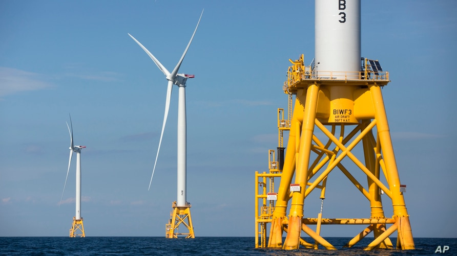 FILE - Three of Deepwater Wind's five turbines stand in the water off Block Island, R.I, the nation's first offshore wind farm, Aug. 15, 2016.