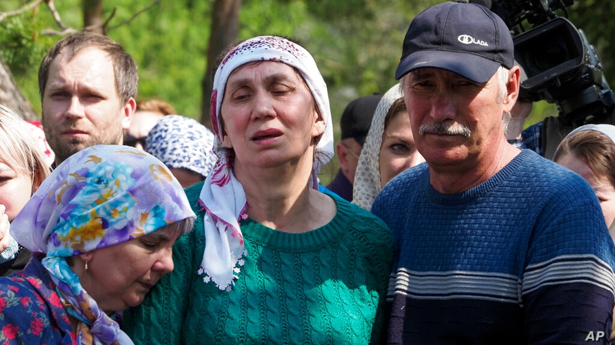 Relatives mourn during the funeral of Elvira Ignatieva, an English language teacher who was killed in a shooting at a school on…
