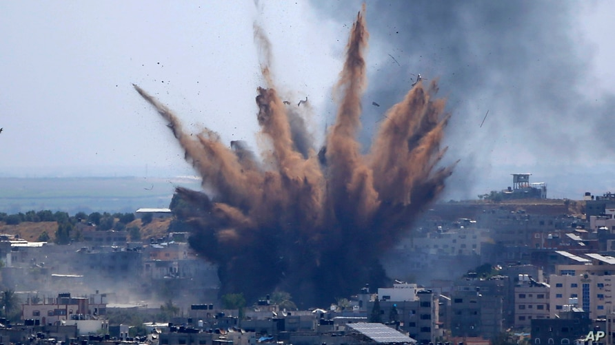 Smoke rises following Israeli airstrikes on a building in Gaza City, Thursday, May 13, 2021.
