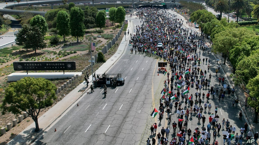 thousands of demonstrators protest outside the Federal Building against Israel and in support of Palestinians, in Los Angeles