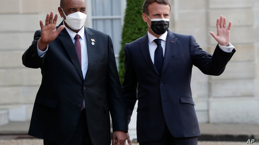 French President Emmanuel Macron, right, welcomes President of the Sudanese Transitional Council General Abdel Fattah al-Burhan…