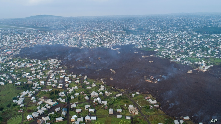 Lava from the eruption of Mount Nyiragongo cuts through Buhene north of Goma, Congo Monday, May 24, 2021. Residents returned to…
