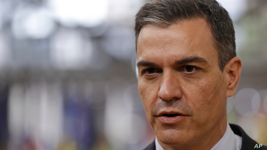 Spain's Prime Minister Pedro Sanchez speaks with the media as he arrives for an EU summit at the European Council building in…