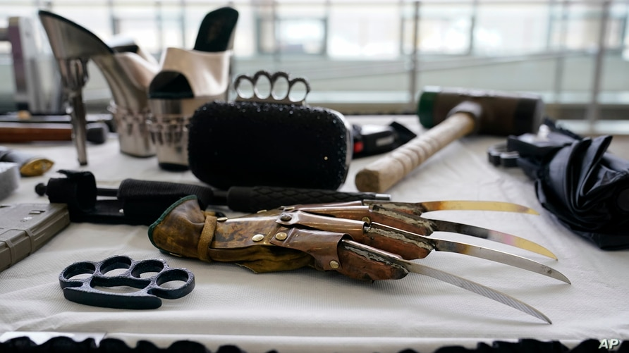 Prohibited items found during screenings at TSA checkpoints are displayed before a news conference on aviation security ahead…