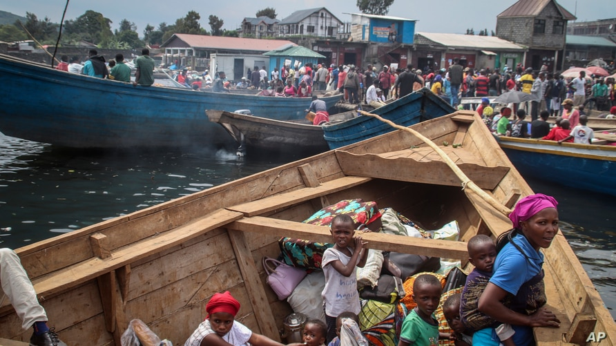 Residents board boats to flee across Lake Kivu in the direction of South Kivu province, at the port of Kituku in Goma, in eastern Congo, May 28, 2021.