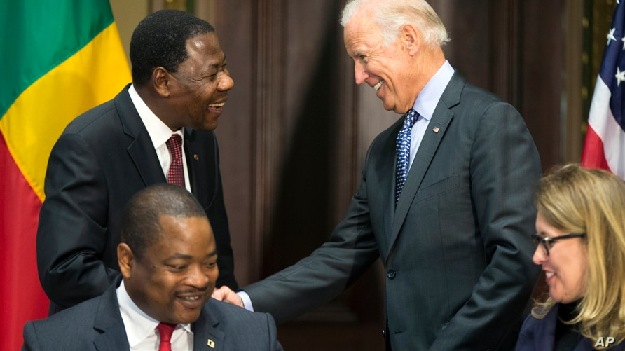 Vice President Joe Biden, right, shakes hands with Benin's president Thomas Boni Yayi, during a Compact Signing Ceremony in the…