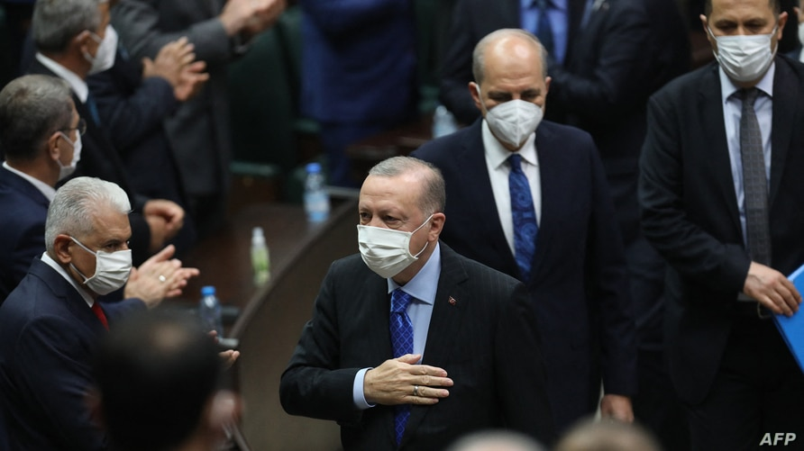 FILE - Turkish president and leader of the ruling Justice and Development Party (AKP), Recep Tayyip Erdogan (C) is seen a party meeting at the Grand National Assembly of Turkey, in Ankara, May 26, 2021.