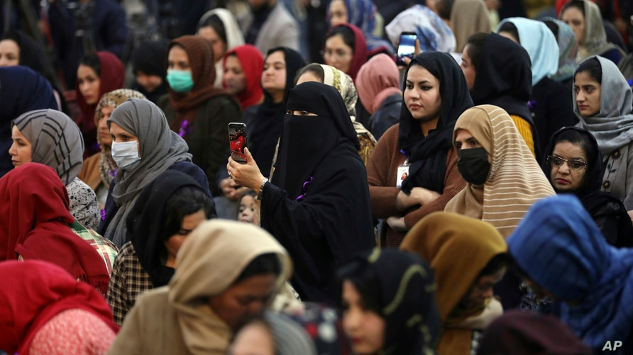 FILE - Afghan women attend an event to mark International Women's Day in Kabul, March 7, 2021.