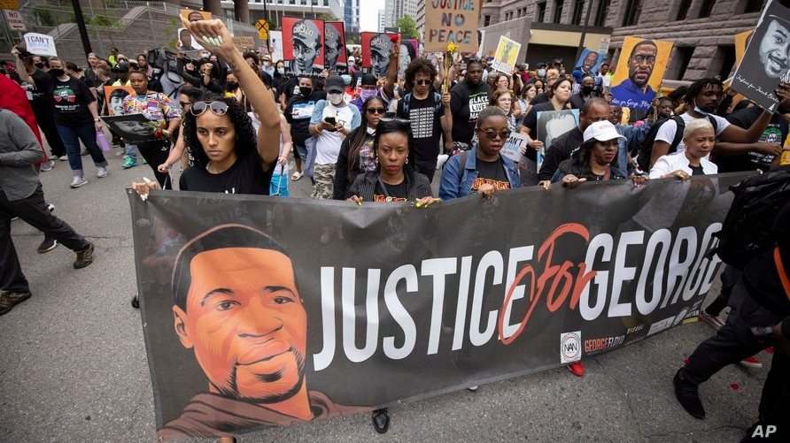 People march for the one-year anniversary of George Floyd's death, in Minneapolis, Minnesota, May 23, 2021.