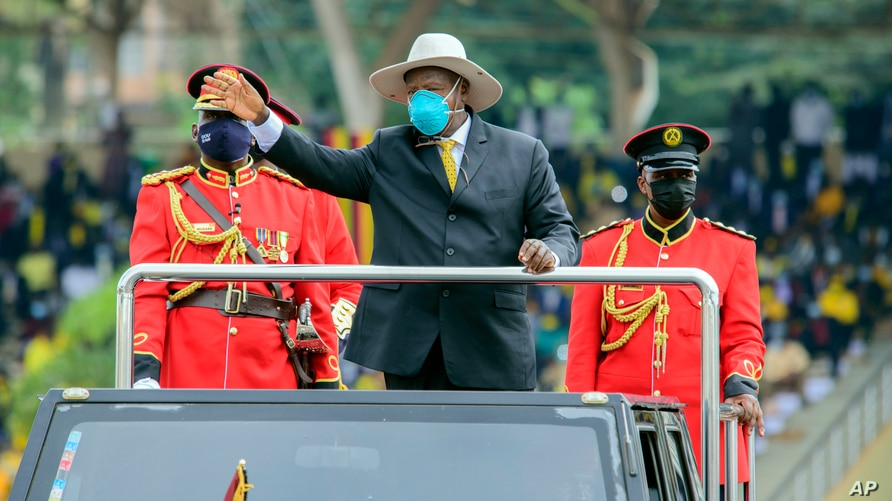Ugandan President Yoweri Museveni waves to the crowd as he arrives to take his oath to be sworn in as president for his sixth term, at Kololo ceremonial grounds, in Kololo, Uganda, May 12, 2021.