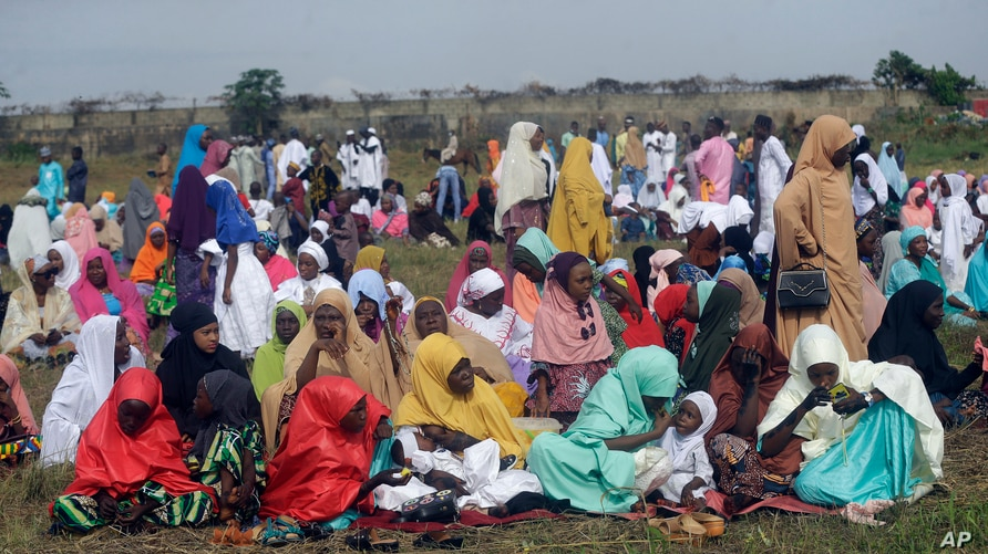 Muslims perform an Eid al-Fitr prayer in an outdoor open area in Lagos, Nigeria, May 13, 2021.