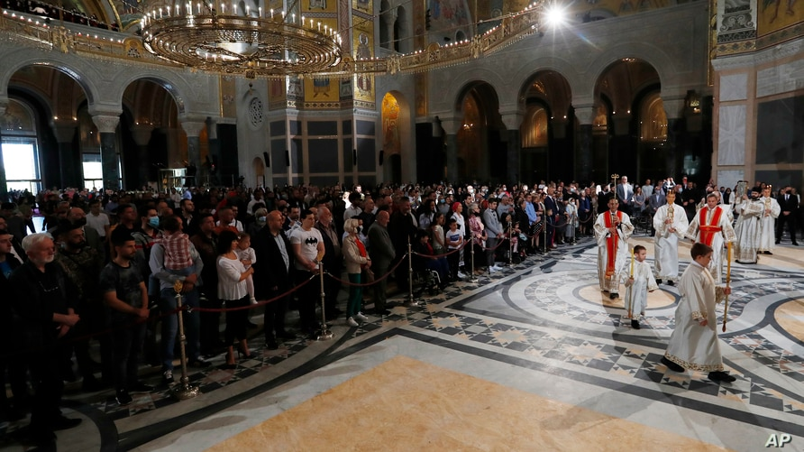 People attend the traditional Orthodox Easter Liturgy in the St. Sava temple in Belgrade, Serbia, May 2, 2021.