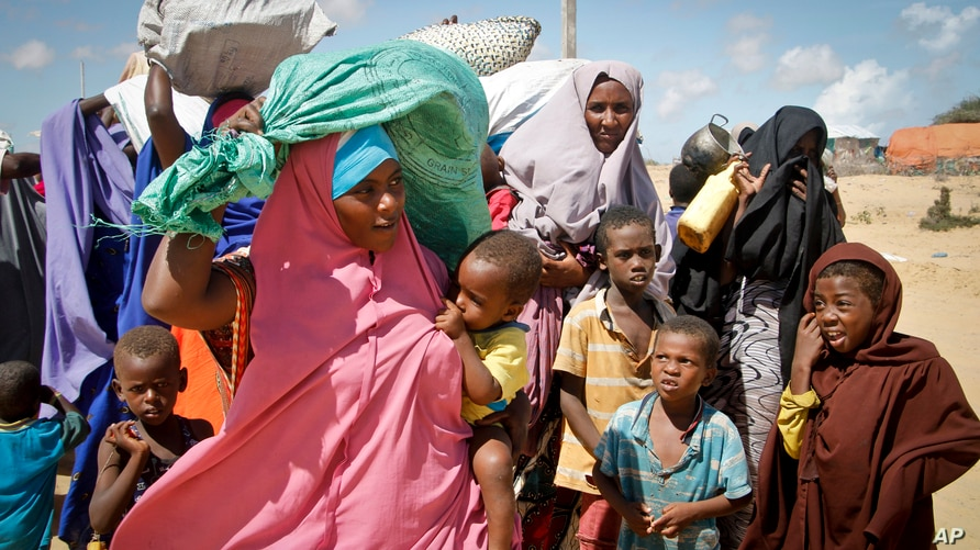 FILE - Somalis fleeing from drought in the Lower and Middle Shabelle regions of the country reach a makeshift camp for displaced persons in the Daynile neighborhood on the outskirts of the capital Mogadishu, May 18, 2019.