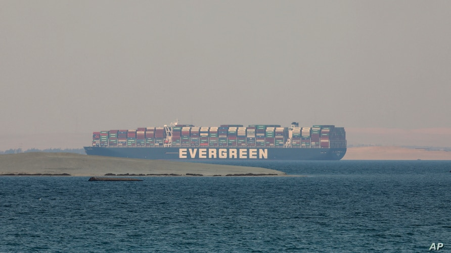 FILE - The Ever Given, a cargo vessel operated by shipping company Evergreen, is seen anchored in Egypt's Great Bitter Lake, March 30, 2021, after blocking the Suez Canal earlier in March.