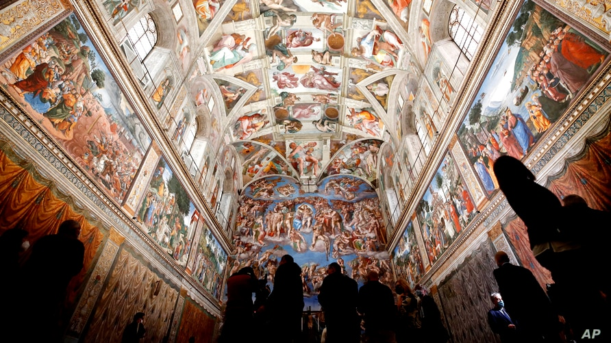Visitors admire the Sistine Chapel of the Vatican Museums as the museum reopens, in Rome, Italy, May 3, 2021.