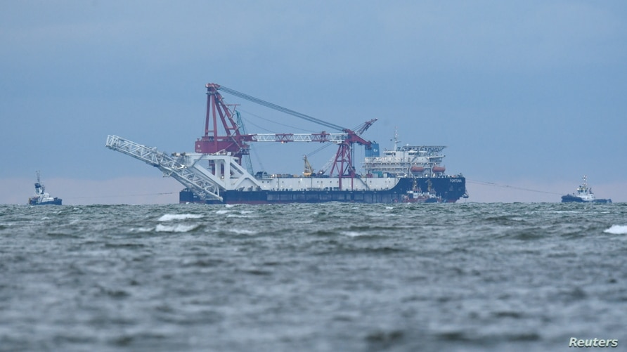 """FILE - The Russian pipe-laying ship """"Fortuna"""" is seen in the Mecklenburg Bay ahead of the resumption of Nord Stream 2 gas pipeline construction near Poel island, Germany, Jan. 14, 2021."""