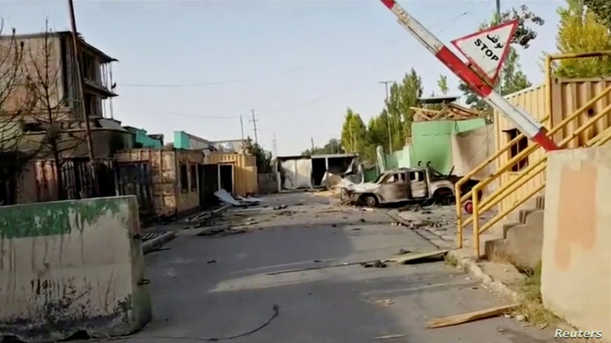 FILE - Damage is seen from a previous attack on a security base in Ghazni City, Afghanistan, in this still image taken from video by Ariana News, Aug. 13, 2018. Taliban insurgents attacked and overran a base outside the provincial capital Saturday.