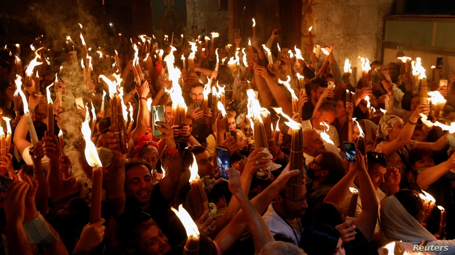 Orthodox Christian worshippers attend the Holy Fire ceremony amid eased COVID-19 restrictions, at the Church of the Holy Sepulchre in Jerusalem's Old City, May 1, 2021.