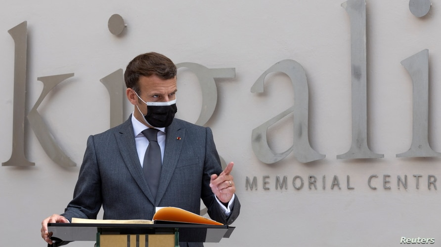 French President Emmanuel Macron speaks after signing a memorial book and laying a wreath at a mass grave containing the remains of 1994 Rwandan genocide victims, at the Kigali Genocide Memorial Center at Gisozi, in Kigali, Rwanda, May 27, 2021.