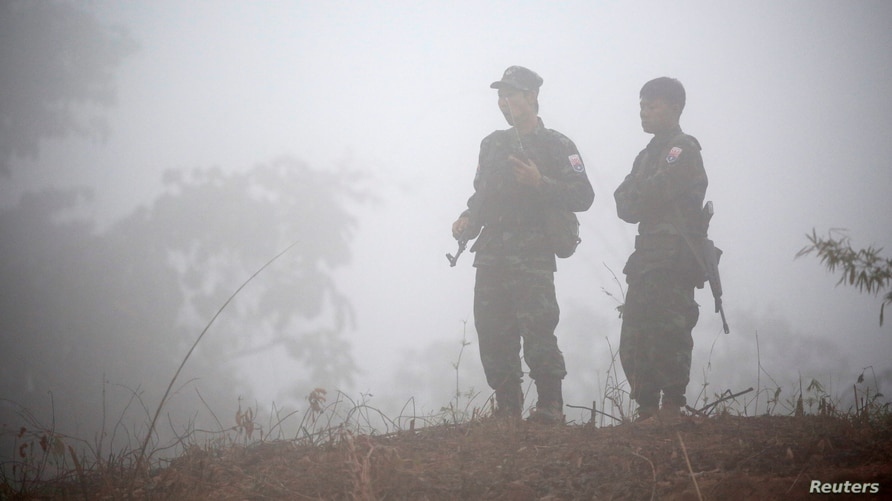 FILE - Fighters opposing Myanmar's military are seen in Kaw Thoo Lei, Kayin state, Myanmar, Jan. 31, 2019. Myanmar's army battled local militia fighters Saturday in the northwestern town of Mindat.