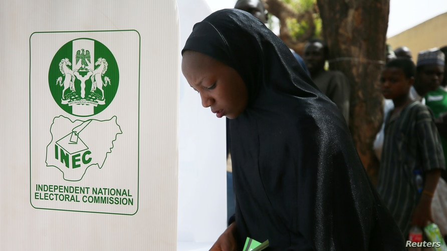 FILE - A woman casts her ballot during Nigeria's presidential election at a polling station in Kazaure, Jigawa state, Nigeria, Feb. 23, 2019. Nigerian election officials say they have recorded at least 42 attacks on its facilities since the 2019 polls.