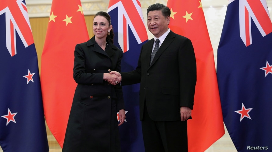 FILE - Chinese President Xi Jinping and New Zealand Prime Minister Jacinda Ardern shake hands before a meeting at the Great Hall of the People in Beijing, China, April 1, 2019.