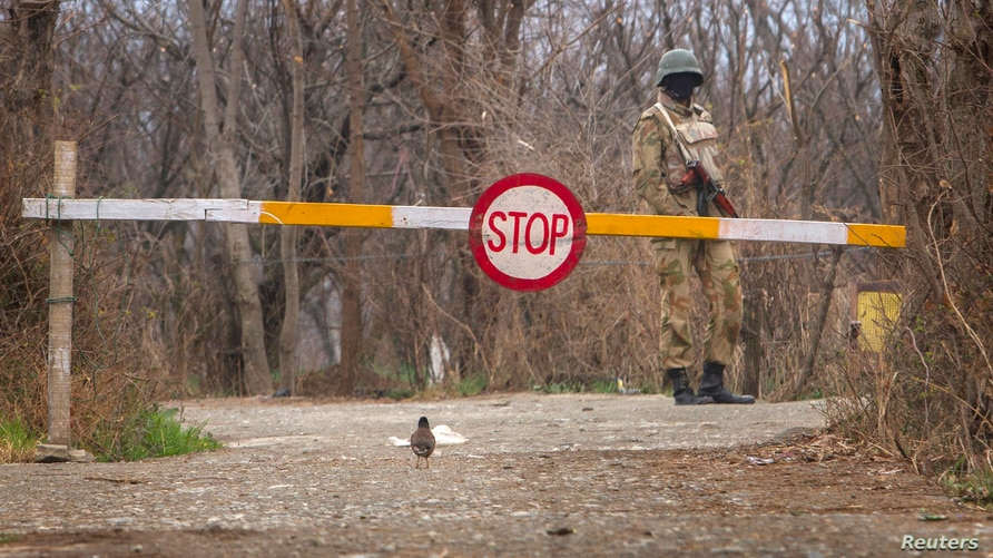 FILE - A Pakistani soldier stands guard at a checkpoint in the town of Khwazakhela, in Pakistan's northwestern Swat valley, home to several of the country's military bases, Feb. 4, 2014.