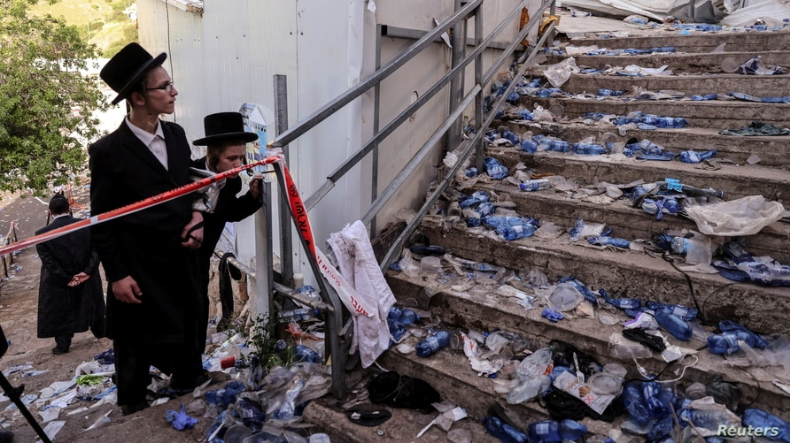 Ultra-Orthodox Jews look at stairs at the site of a deadly stampede that marred a religious festival in Mount Meron, northern Israel, April 30, 2021.