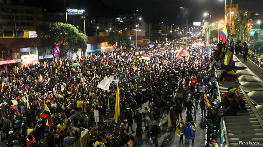 People take part in a protest against sexual assault by the police and the excess use of force against peaceful protests, in Bogota, Colombia, May 15, 2021.