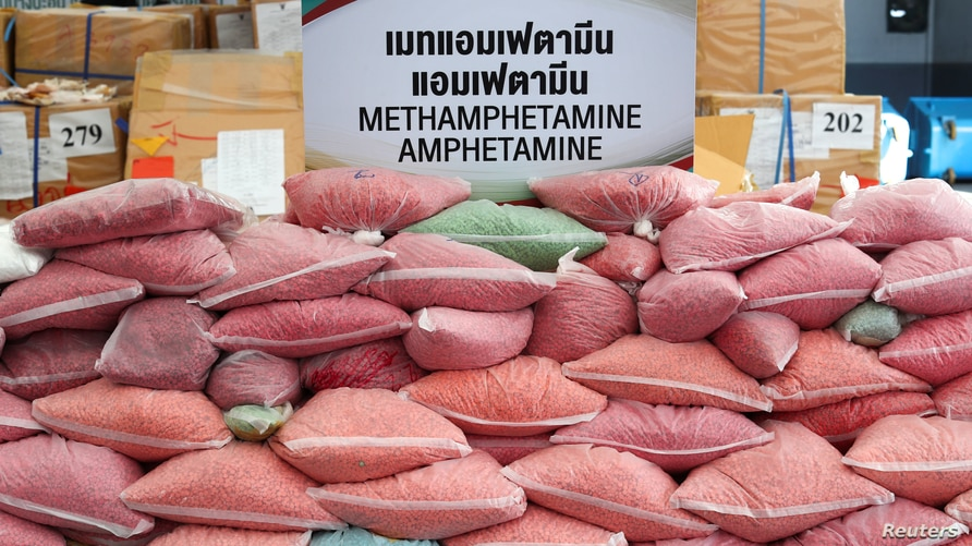 FILE - Bags of methamphetamine pills are pictured during the 50th Destruction of Confiscated Narcotics ceremony in Ayutthaya province, Thailand, June 26, 2020.