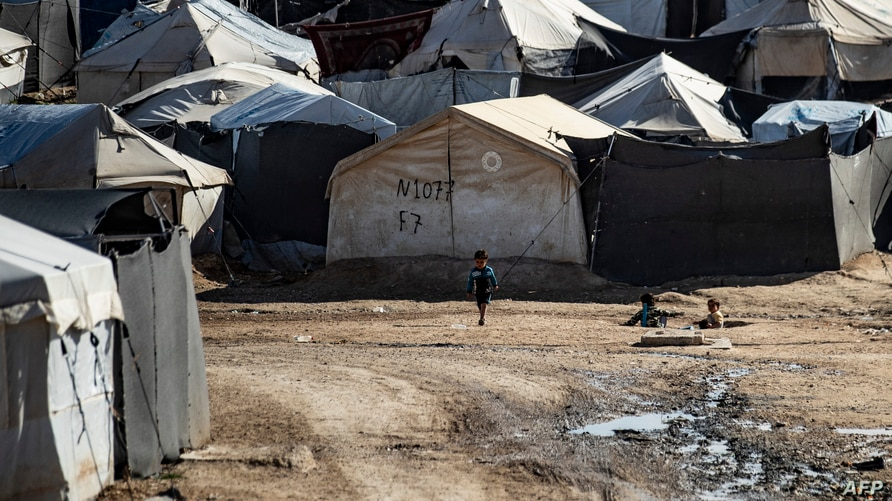 Children play among tents at the Kurdish-run al-Hol camp which holds suspected relatives of Islamic State (IS) group fighters,…