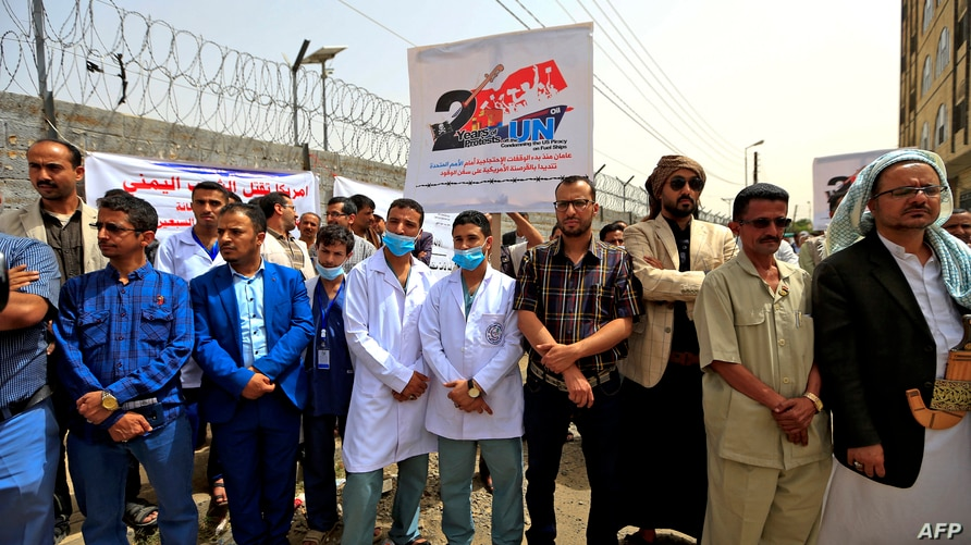 Yemeni healthcare workers protest against severe fuel shortages outside the United Nations office in the rebel-held capital…