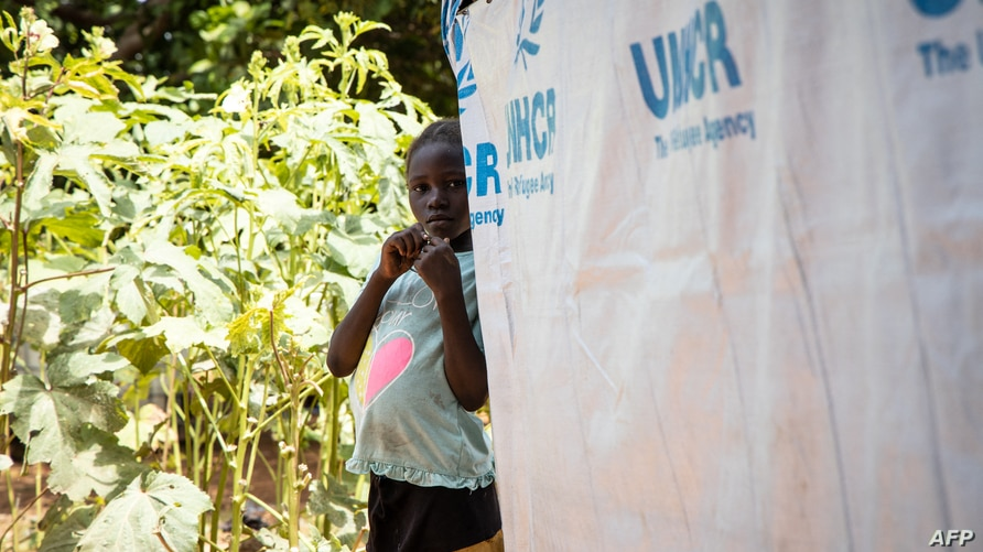 A young girl Internally displaced people (IDP) stands  by her shelter, in Kaya on October 14, 2020. (Photo by Olympia de…