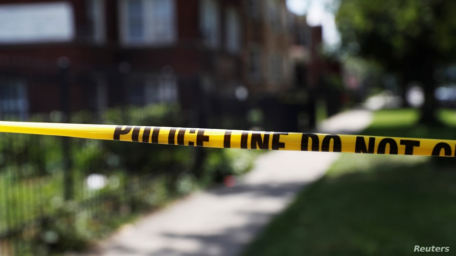 Chicago police crime scene tape is posted at the scene of a gun shooting on the South Side of Chicago, Illinois, U.S., July 26,…